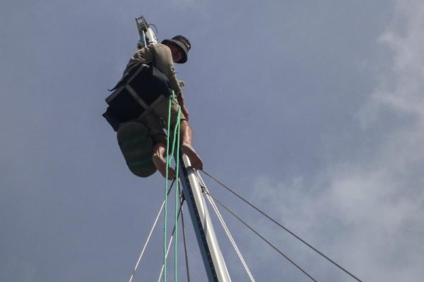Our rigger, Gerry, up the mast