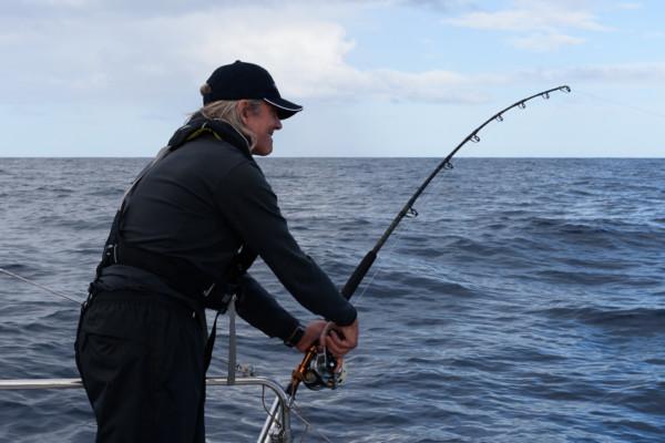 Monty reeling in a fish
