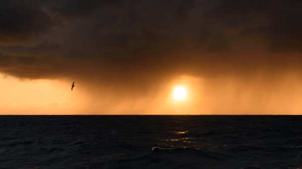 Sunset fighting through a squall